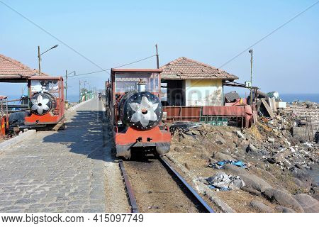 ELEPHANTA ISLAND, INDIA - JANUARY 10, 2017: Elephanta Island Toy Train. In Mumbai Harbor the island is known for its cave temples, the Elephanta Caves, that have been carved out of rock.