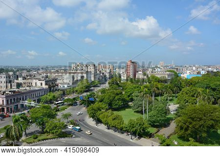 HAVANA, CUBA - JULY 24, 2016: Havana City seen from the Iberostar Parque Central Hotel. In the foreground is Parque Central looking towards the city.