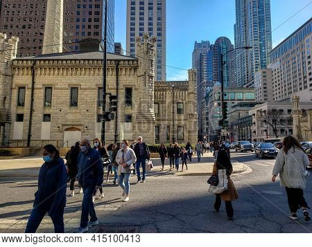Chicago, Il March 13, 2021, People Shoppers Walking Down The Sidewalk On Michigan Avenue Wearing Mas