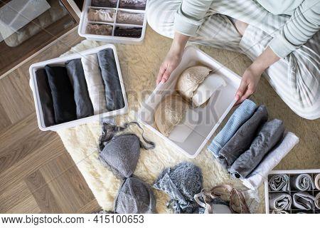 Female Hands Organizing Storage Of Underwear Socks T Shirts Use Marie Kondos Method. Perfectionist