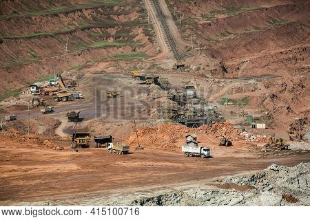 Mining Dump Trucks Working In Coalmine , Used As A Source Of Electricity Generation In The Country.