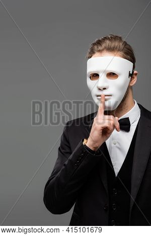 Businessman In Face Mask Showing Hush Sign Isolated On Grey.