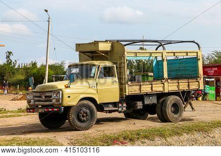 Kajiado County, Kenya - February 9, 2021: Old Flatbed Truck Isuzu Tx In The Village Street.