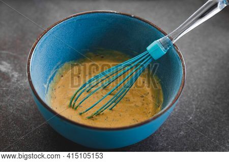 Vegan Batter Mix For Savoury Muffins With Olives And Nutritional Yeast In Bowl With Whisk, Healthy P