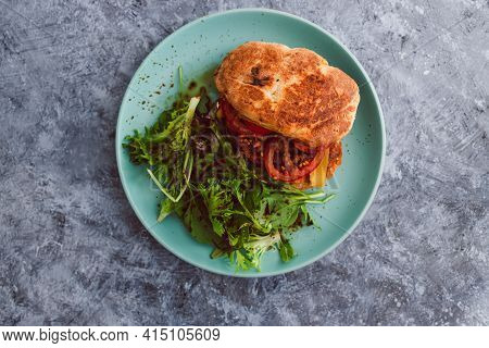 Vegan Burger With Turkish Bread Bun Tomatoes Dairy-free Cheese And Plant-based Patty Served With Sid