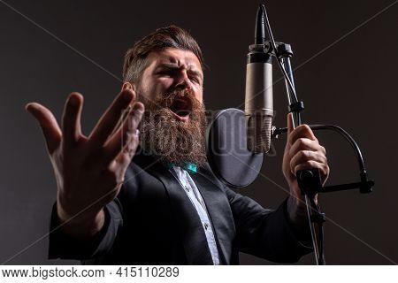 Classic Singer In Suit. Handsome Man In Recording Studio. Music Performance Vocal. Singer Singing So