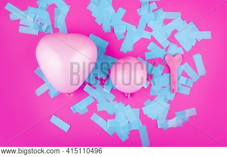 Three Pink Balloons For Helium And Air In The Shape Of A Heart Of Different Sizes On A Bright Pink B