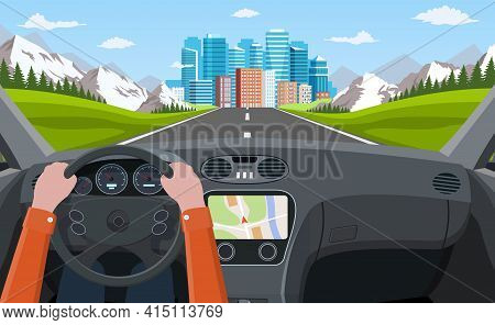 View Of The Road From The Car Interior. Road Way To City Buildings On Horizon. Hands On Steering Whe