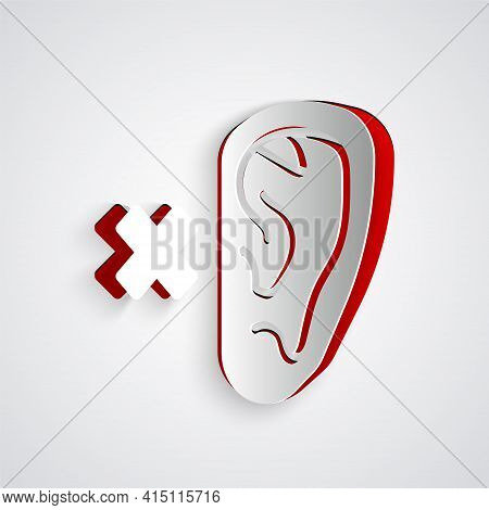 Paper Cut Deafness Icon Isolated On Grey Background. Deaf Symbol. Hearing Impairment. Paper Art Styl
