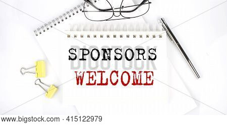 Sponsors Welcome Text On Notebook With Pen,clips And Glasses