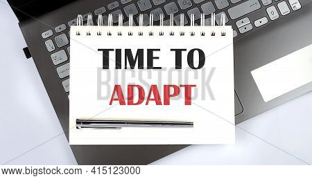 Time To Adapt - Top View Notebook Writing On Laptop