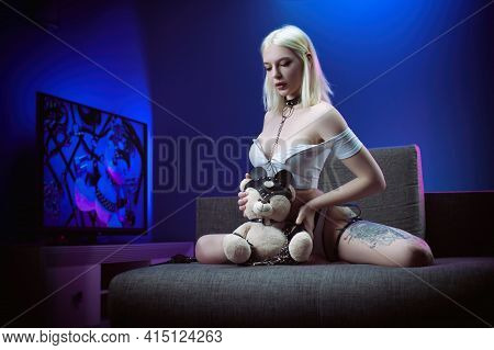 Sexy Woman In White Lingerie On The Couch With A Teddy Bear Bdsm