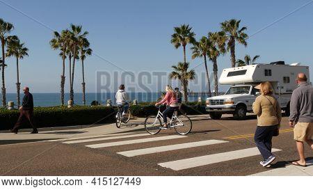Oceanside, California Usa - 8 Feb 2020: Motorhome, People Riding Bikes On Ped Crossing Zebra, Waterf