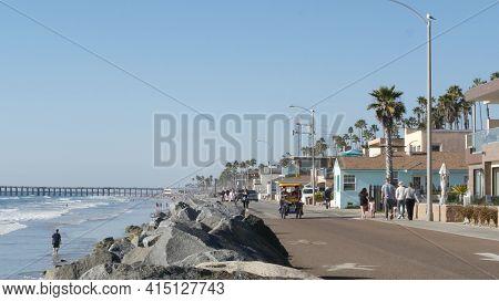 Oceanside, California Usa - 16 Feb 2020: People Walking Strolling On Waterfront Sea Promenade, Beach