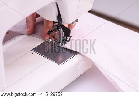 Close-up Image Of Seamstress. Seamstress Sews Fulfills An Order.