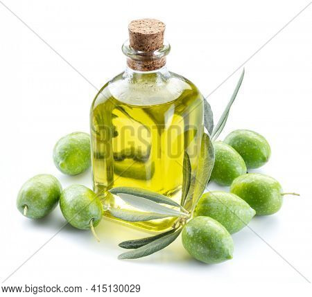 Green natural olives with bottle of olive oil isolated on a white background.