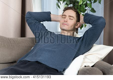 Portrait Of Relaxed Happy Guy, Young Handsome Sleeping, Enjoying, Resting Man Having A Nap At Comfor