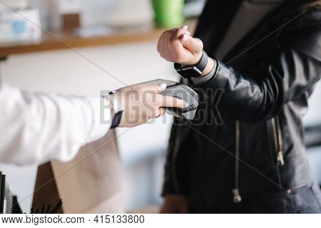 Female Customer Making Wireless Or Contactless Payment Using Smartwatch. Closeup Of Hands During Pay