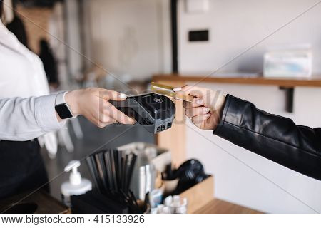 Female Customer Making Wireless Or Contactless Payment Using Credit Card. Closeup Of Human Hands Dur