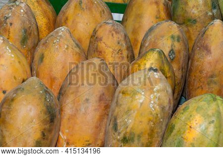 Papaya Fruit In Supermarket - Scientific Name: Carica Papaya.