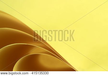 Abstract Colored Macro Background, Created With Curved Yellow Paper Sheets. Curved Lines And Shapes