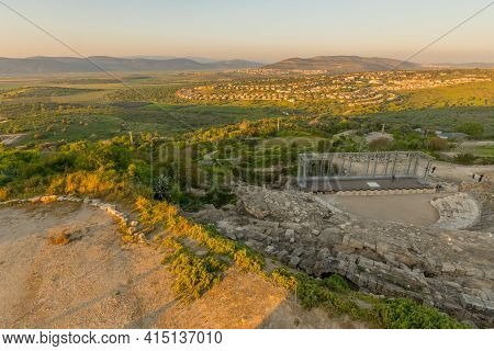 Tzipori, Israel - March 29, 2021: Sunset View Of The Ancient Roman Theater, With Visitors, Landscape