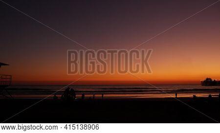 Oceanside, California Usa - 8 Feb 2020: Silhouette Of People Making Bbq Campfire. Beachfront Recreat