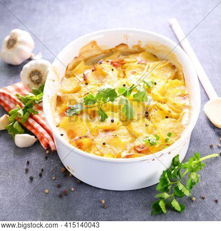 potato gratin with cream, garlic and cheese- gratin dauphinois
