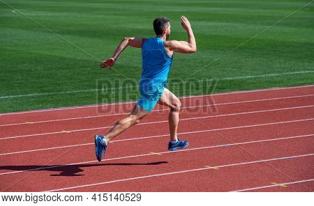 Athlete Runner Do Aerobic Or Anaerobic Load. Man Start Running On Stadium. Fitness Gym Outdoor. Musc