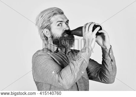 Hipster Rest In Pub. Sports Lover Cheer Up. Mature Man Holding Glass Bottle Of Beer. Drunk Hipster M