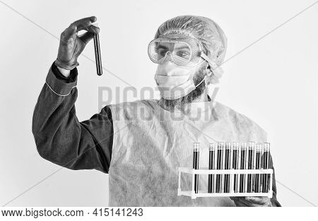 Scientist Test Tubes With Blood Samples. Detection Of Antibodies. Detection Of Virus. Man Work At La