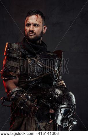 Bearded Apocalyptic Survivor With Helmet In Dark Background