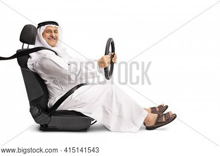 Arab man with a seatbelt holding the steering wheel and smiling isolated on white background