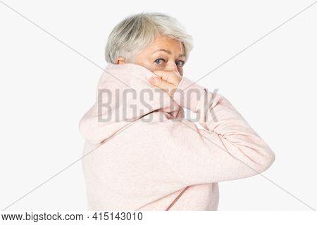 Mature woman posing in pink hoodie loungewear apparel rear view