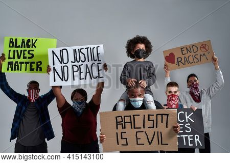 Young Multiracial People And African American Kid Holding Anti Racist Posters And Wearing Buffs Stan