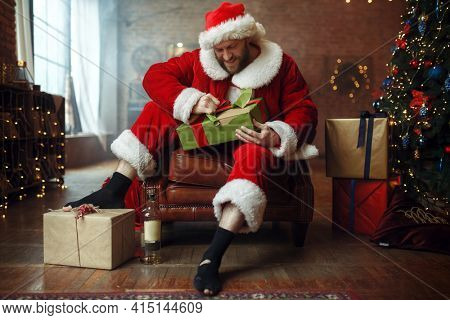 Bad drunk Santa claus opens gifts, humor