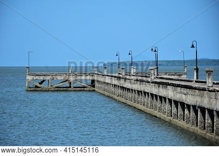 Concrete Jetty Into The Sea In Thailand On Blue Sky Background