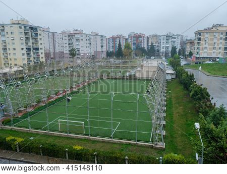 Some Empty Astro Turf Football Goal Net Sport Fields Near The Apartments And Buildings In Winter Tim