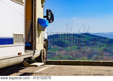 Camper Door With Trash Can.