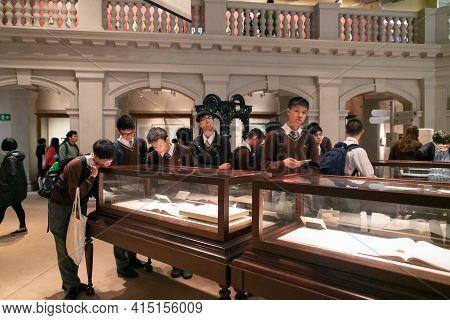 Hong Kong, China - January 20, 2016: Hong Kong History Museum Interior View. School Boys Study Expos