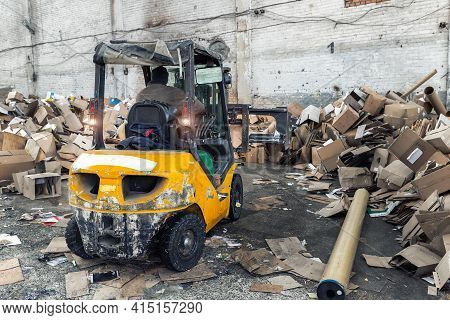 Worker Using Forklift Machine Equipment Facility At Scrap Paper Cardboard Wrap Box Recycling Factory