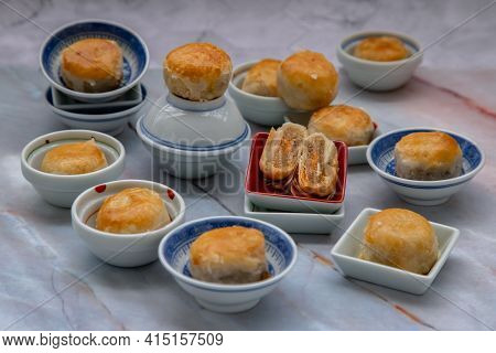 A Traditional Asian Pastry Or Tao Sor On Marble Table. Chinese Sweet Pastry Filled With Mung Bean Pa