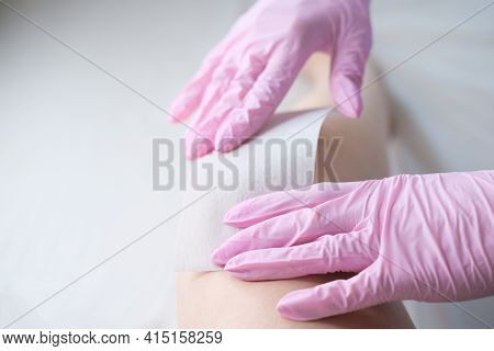 Waxing Salon Or Spa. Hair Removal Using Wax.Concept - sugar paste or hair removail.