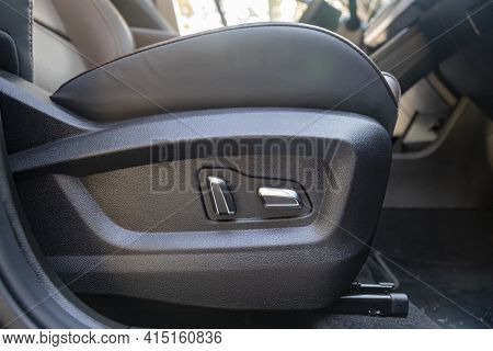 Car Seat Electronic Switch Button. Lever For Electronic Seat Adjustment In A Modern Premium Car. Sea