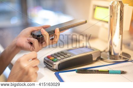 Customer Making Wireless Or Contactless Payment Using Smartphone Scan Qr Code For Pay Money  Without