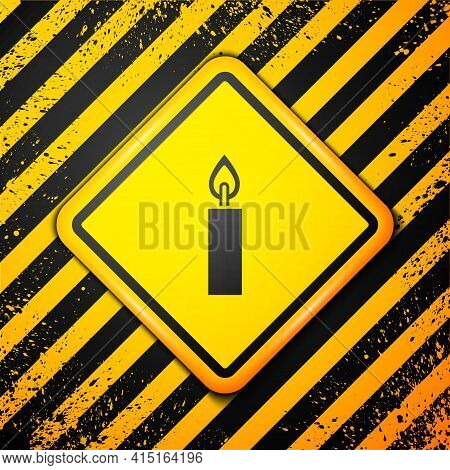 Black Burning Candle Icon Isolated On Yellow Background. Cylindrical Candle Stick With Burning Flame