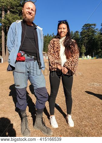 A European Man And Asian Girl Standing In Outdoor, Two Different Countries People Standing Together