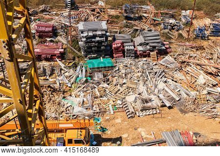 Architecture Building And Construction Site Industry. A Pile Of Iron Materials Stored On The Constru