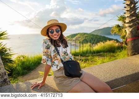 Travelers At Phromthep Cape Viewpoint At The South Of Phuket Island, Thailand. Tropical Paradise In