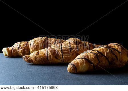 Croissant Coffee. Fresh Pastry Bread Or French Breakfast Croissants With Chocolate In Bakery On Blac